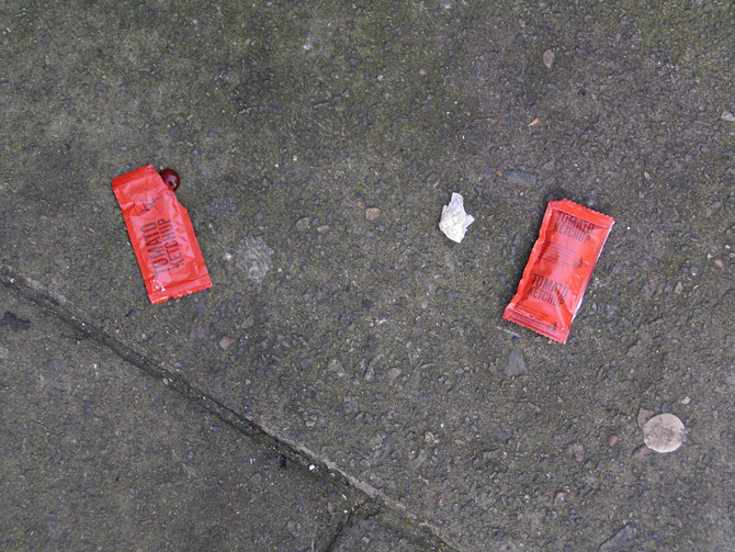Sachets of KFC tomato sauce - oddly one front and one back.